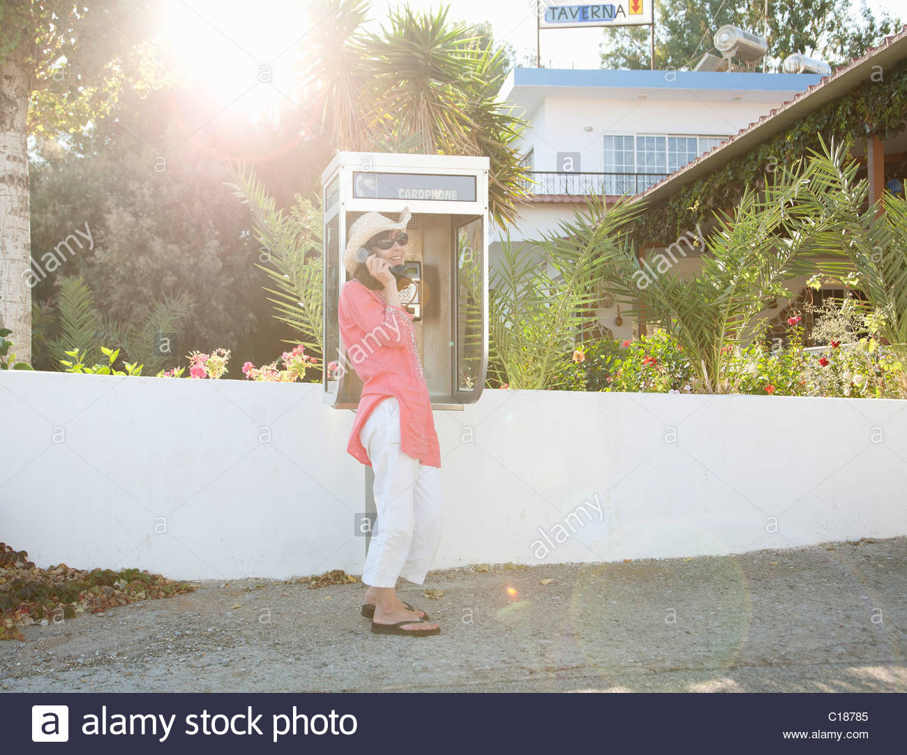 Woman on payphone in street - Stock Image