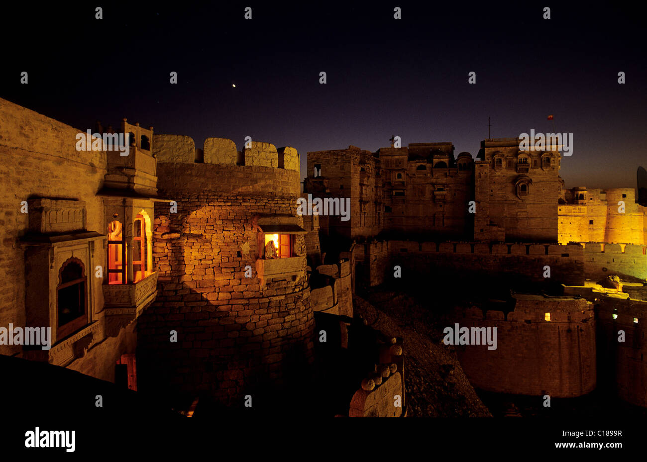 India Rajasthan State Jaisalmer fort the Raj Mahal Palace & the lighted window of the small French owned hotel - Stock Image
