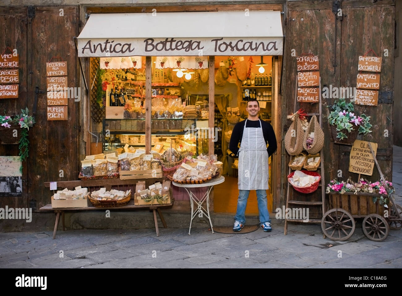 Owner standing in front of deli - Stock Image