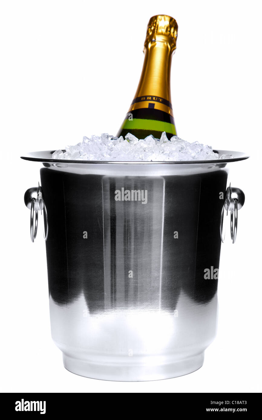 Photo of a champagne bottle in a silver ice bucket isolated on a white background. Stock Photo