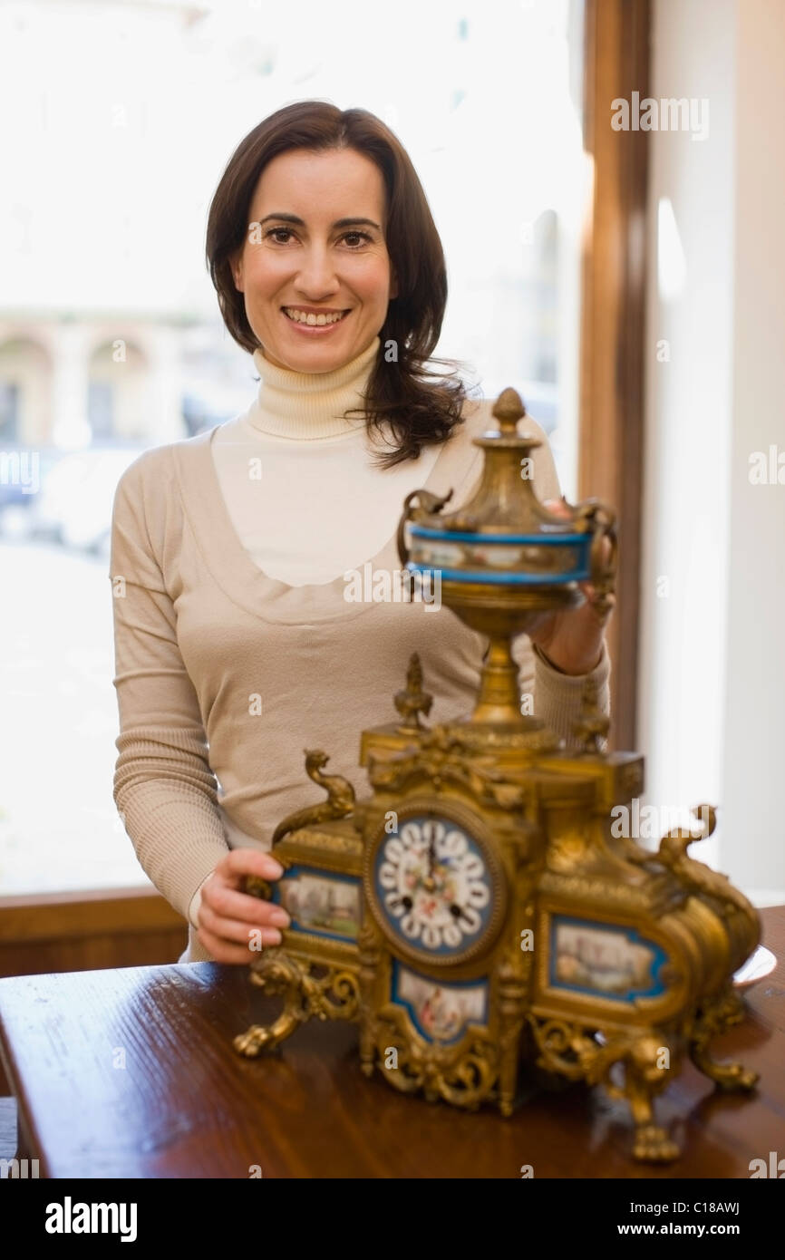 Woman with antique clock - Stock Image