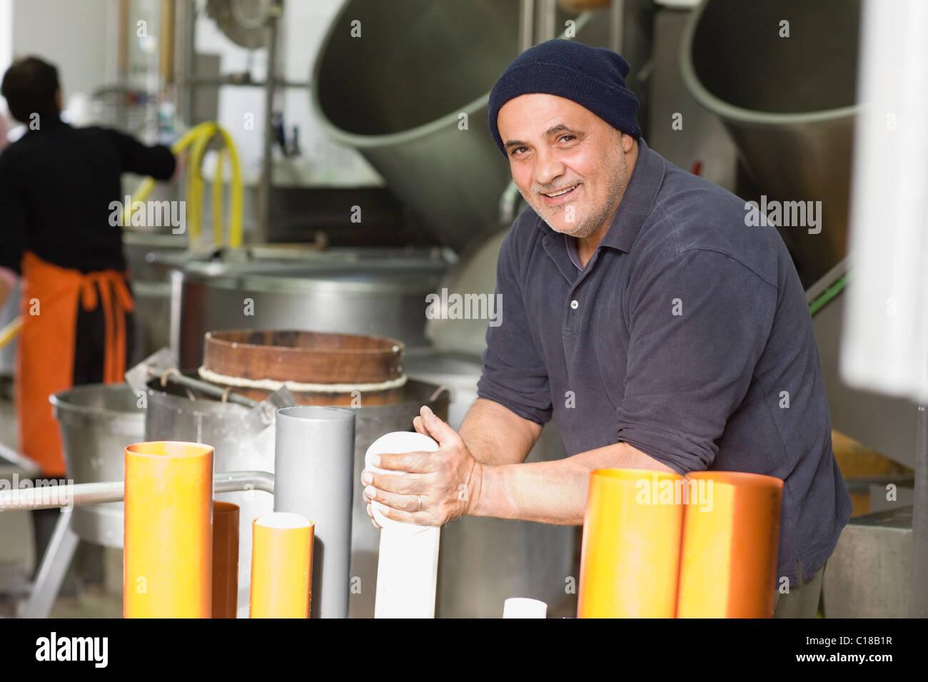 Artisan bison mozzarella production - Stock Image