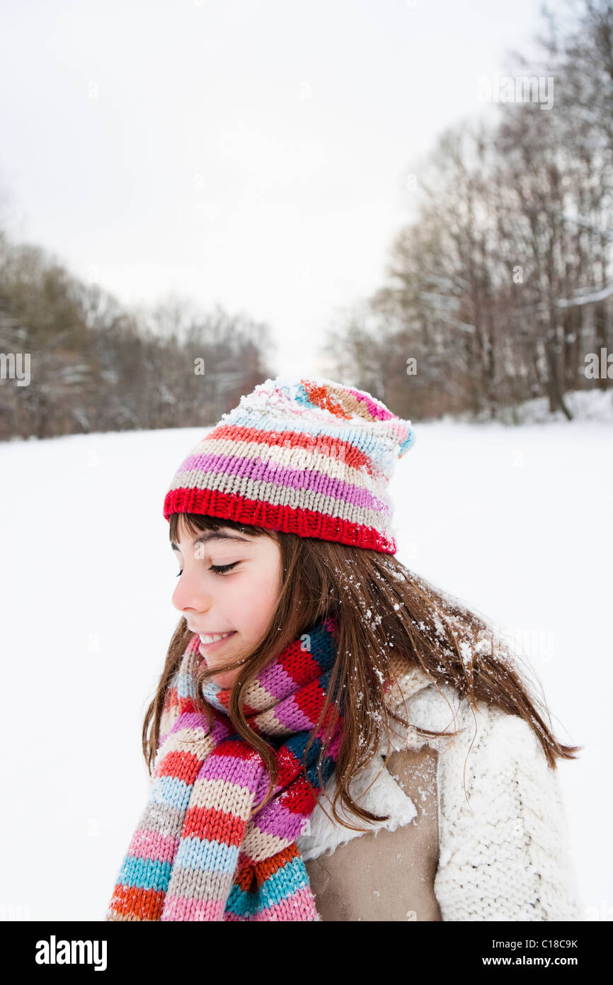 Girl standing in snowfield - Stock Image