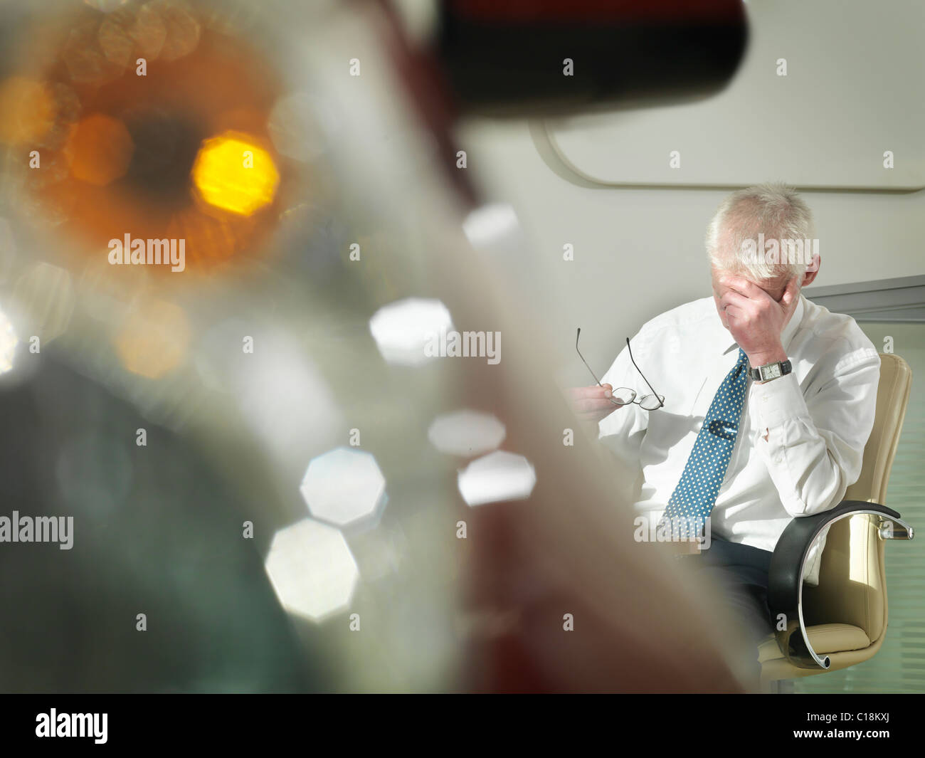 Salesman stressed or tired with car - Stock Image