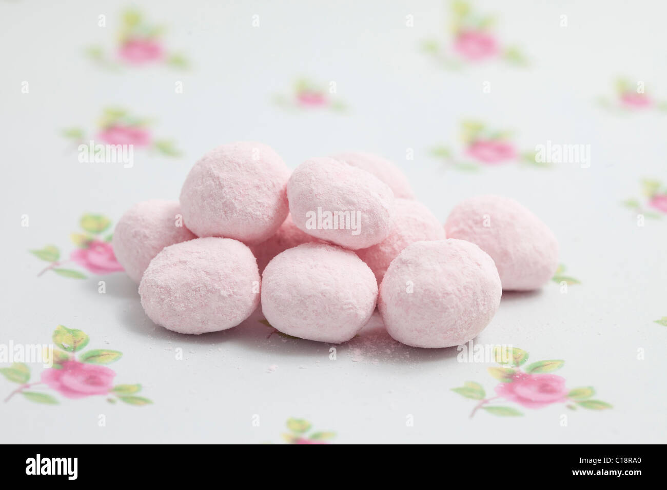 strawberry bonbons sweets and candy on a paper background photographed in a studio - Stock Image