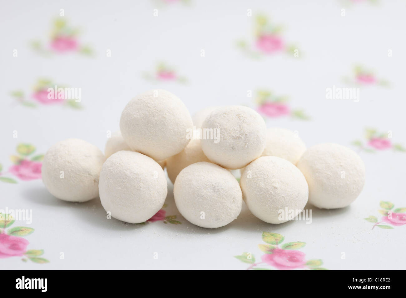 lemon bonbons sweets and candy on a paper background photographed in a studio - Stock Image