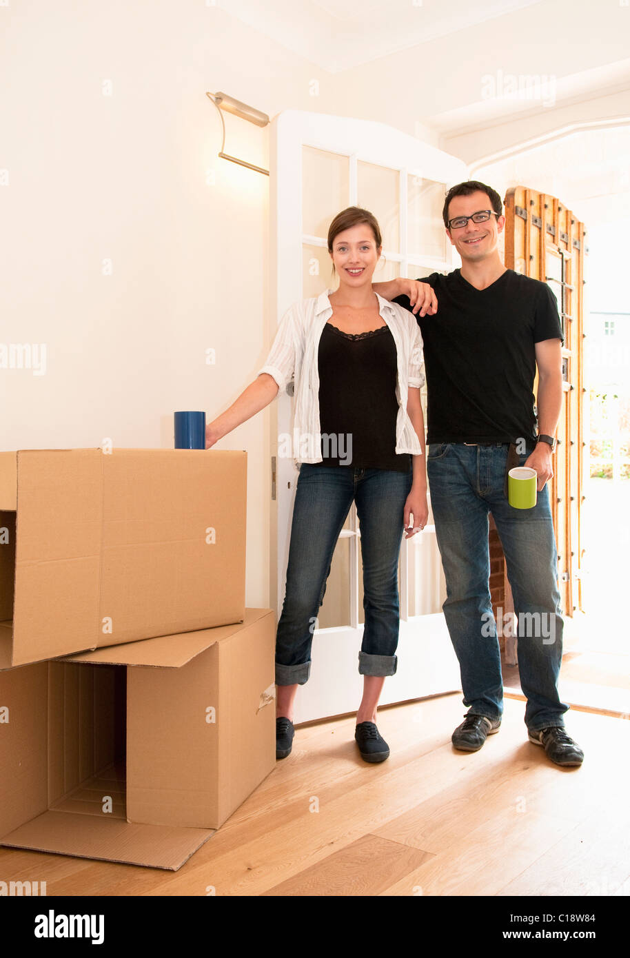 Happy couple just  finished moving in - Stock Image
