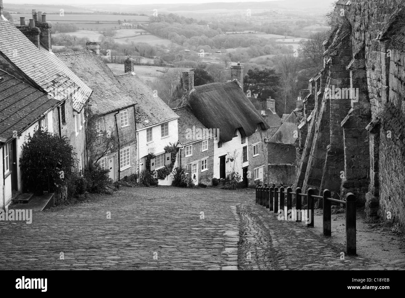 Gold Hill, a famous steep cobbled street in Shaftesbury, Dorset,  England, UK, United Kingdom, GB, Great Britain, Stock Photo