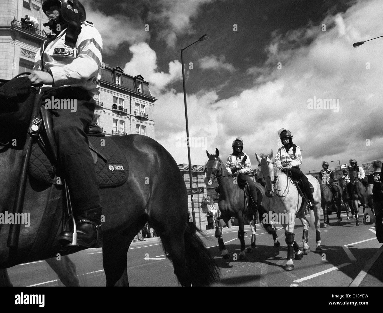 British Riot Police fight to control demonstrators of the EDL (English Defence League) at Bradford. - Stock Image