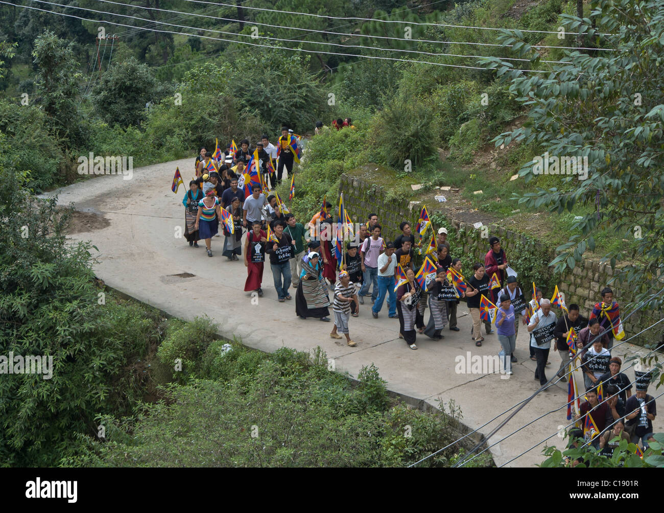 Tibetan men and women march in protest in India - Stock Image