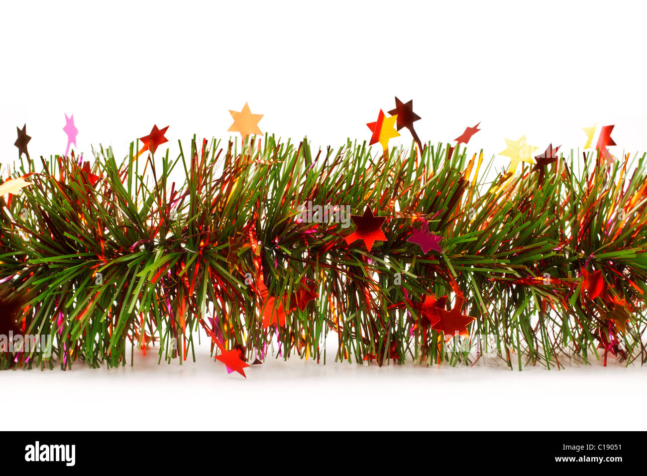 christmas tinsel garland with stars, isolated on white - Stock Image