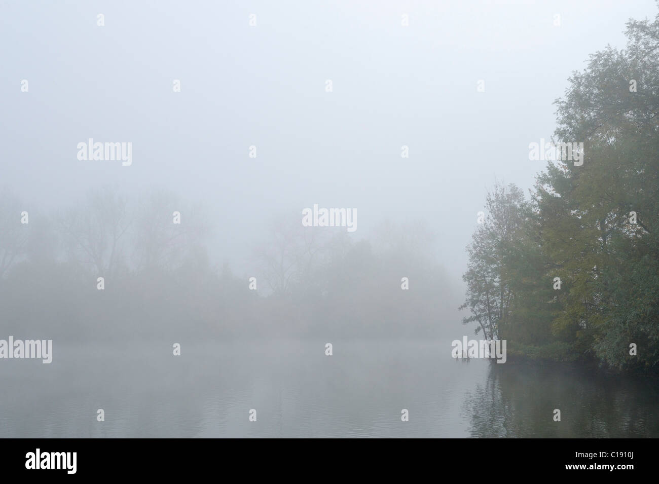 Fog over pond in autumn Stock Photo