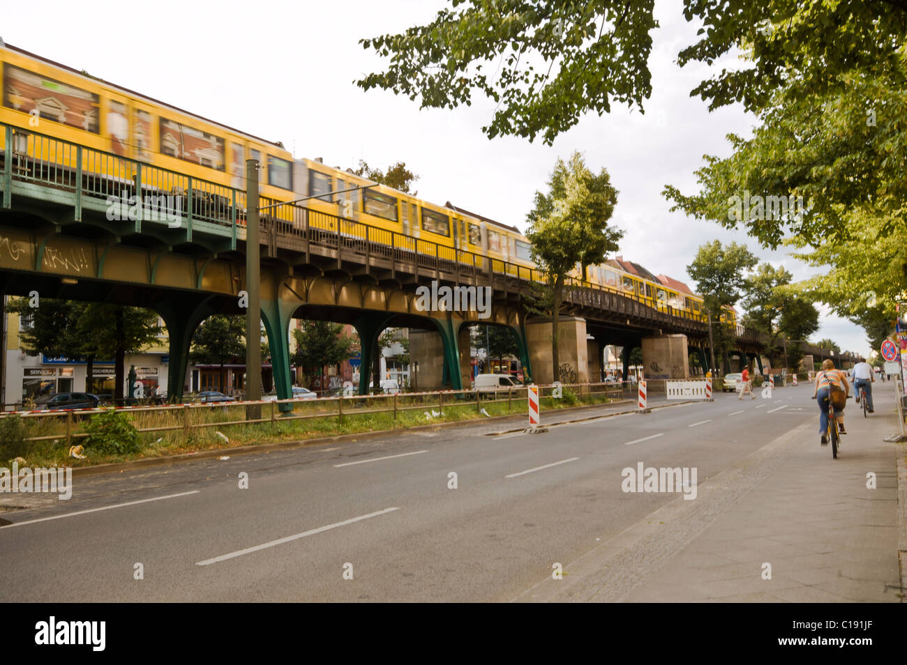 The S-Bahn tracks run through the middle of Schoenhauser Allee in Berlin Stock Photo