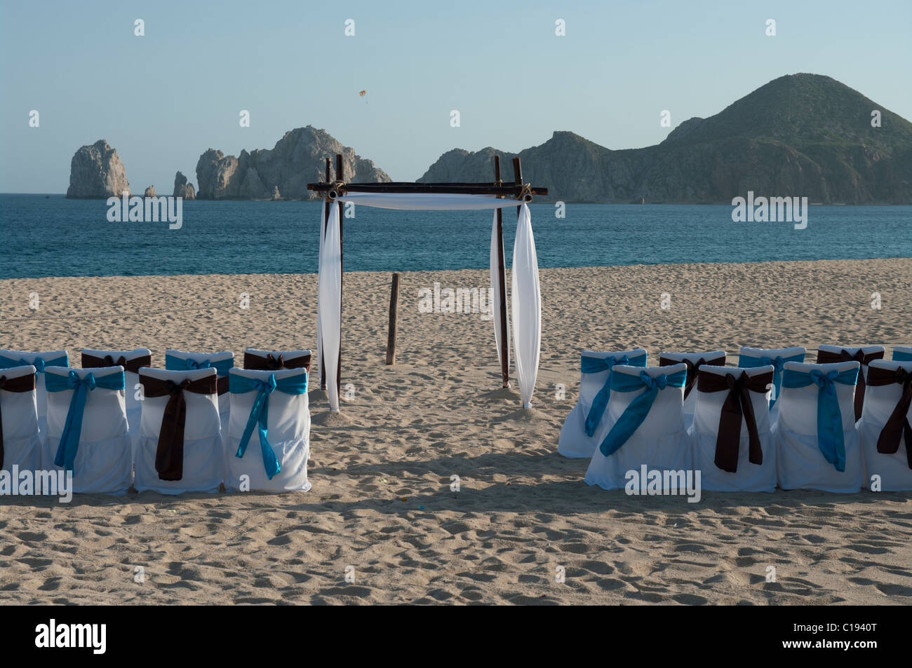 A Deserted Beach Set Up For A Wedding Ceremony. The Chair