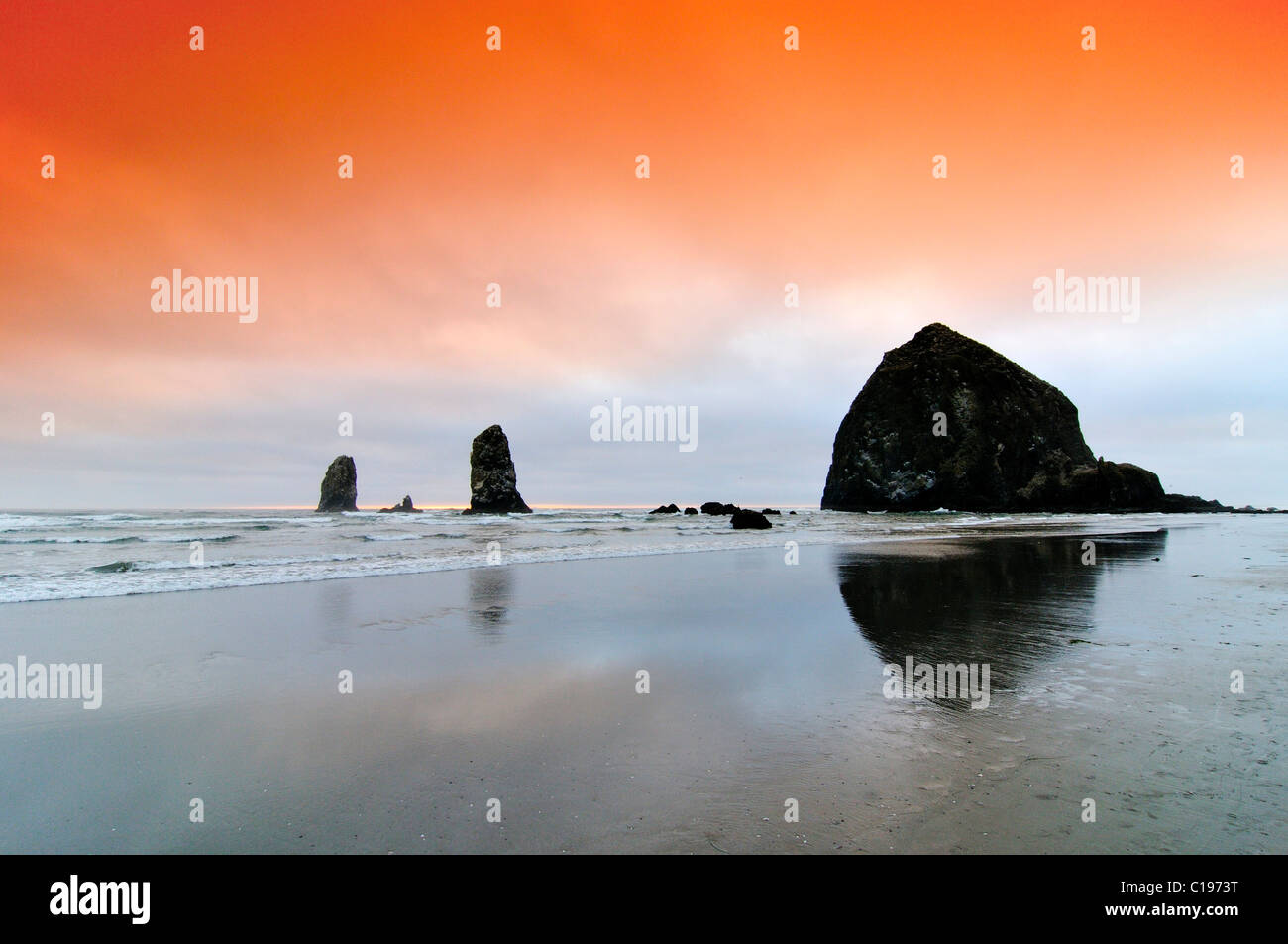Famous 'Haystack Rock' monolith, solidified lava rock at Cannon Beach, tourist attraction, Clatsop County, - Stock Image