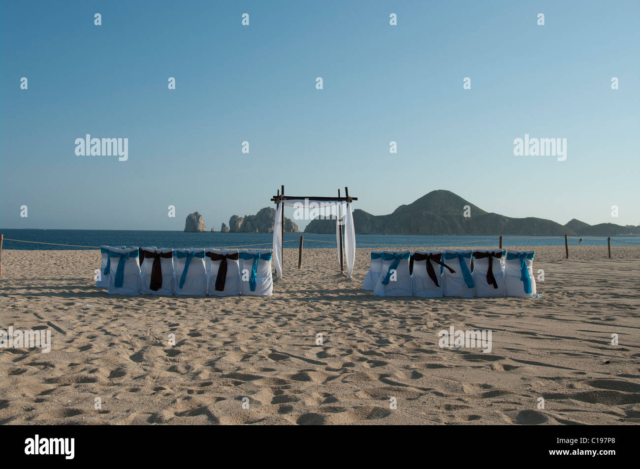 A Deserted Beach Set Up For A Wedding Ceremony The Chair Covers Are Stock Photo Alamy