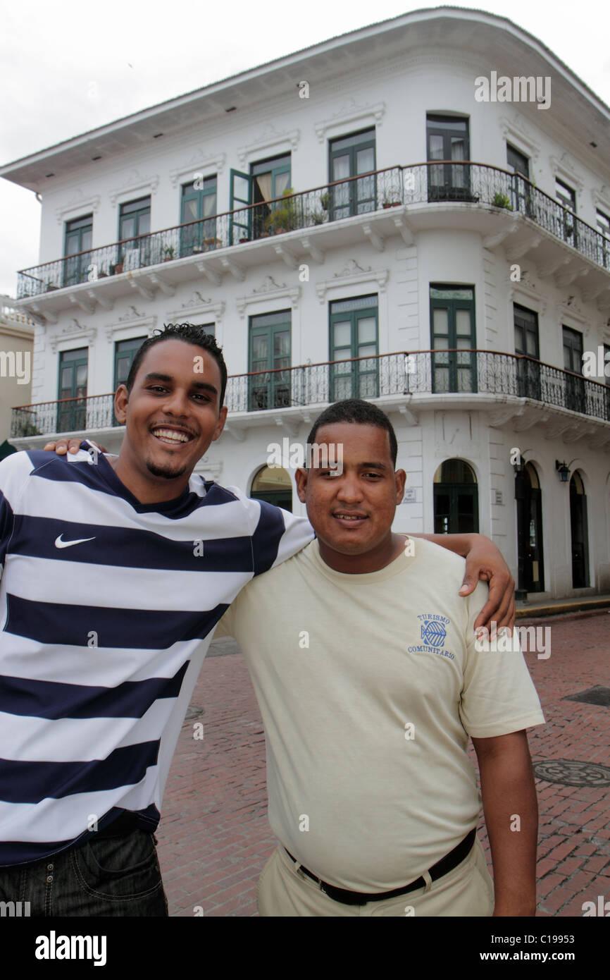 Panama City Panama Casco Viejo San Felipe historic neighborhood Hispanic man men Mestizo smiling arm over shoulder - Stock Image