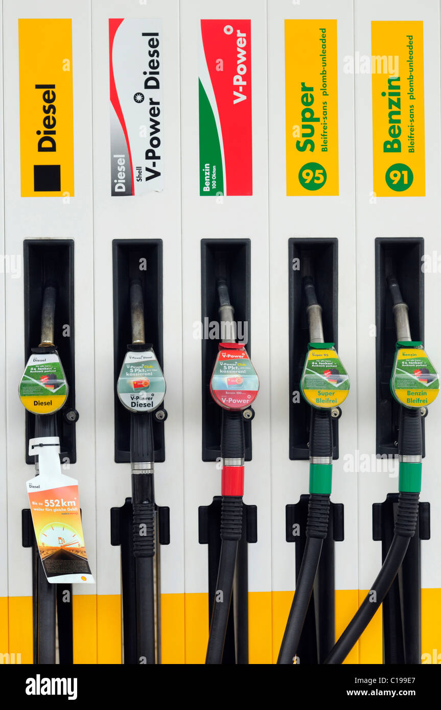 Petrol pump, nozzles of different types of petrol and diesel - Stock Image