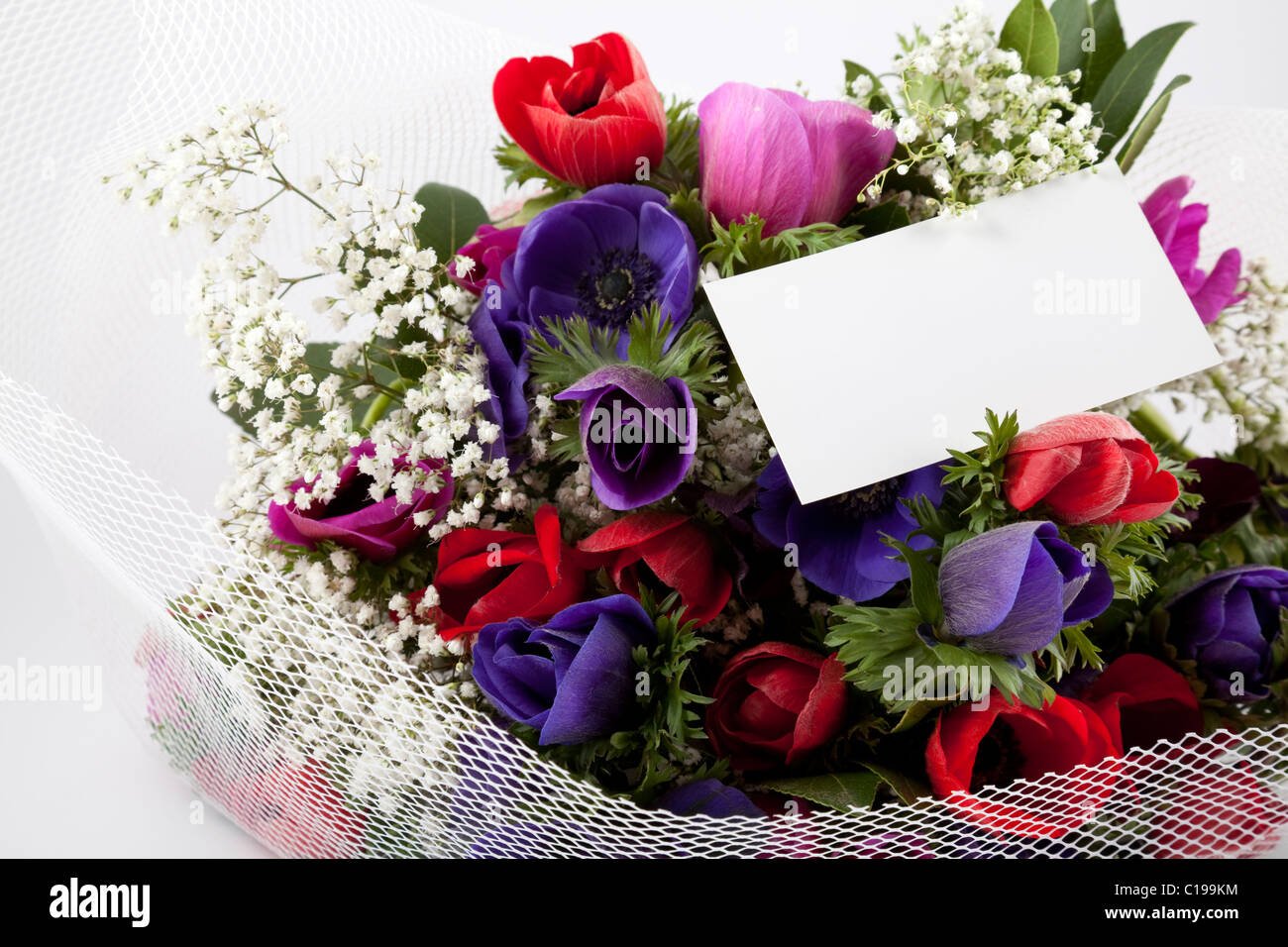 Beautiful bouquet flowers blank white stock photos beautiful beautiful bouquet of flowers with blank white card to put your message stock image izmirmasajfo