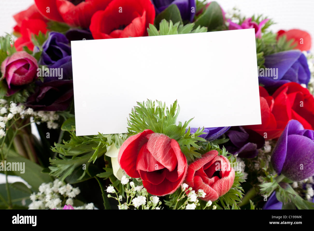 Beautiful bouquet of flowers with blank white card to put your stock beautiful bouquet of flowers with blank white card to put your message izmirmasajfo