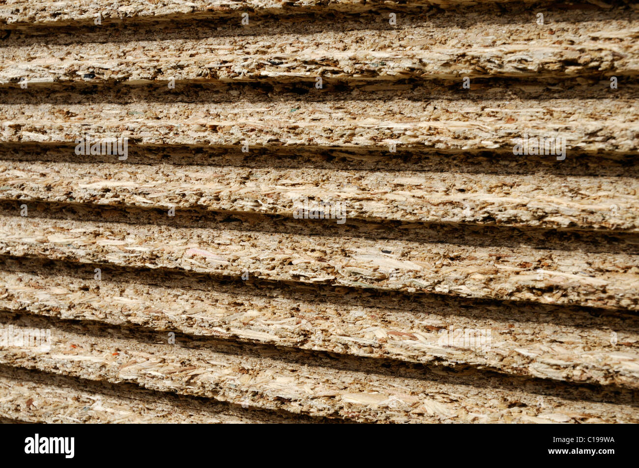 Stacked chipboards, front edge with notch, timber industry - Stock Image