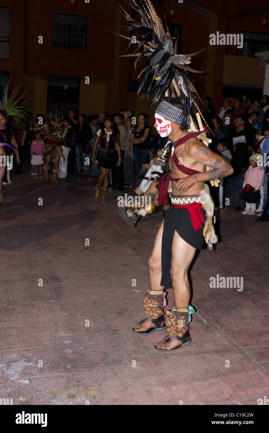Man dressed as an Aztec warrior performing a dance on the day of the dead in Xochimilco, Mexico Stock Photo