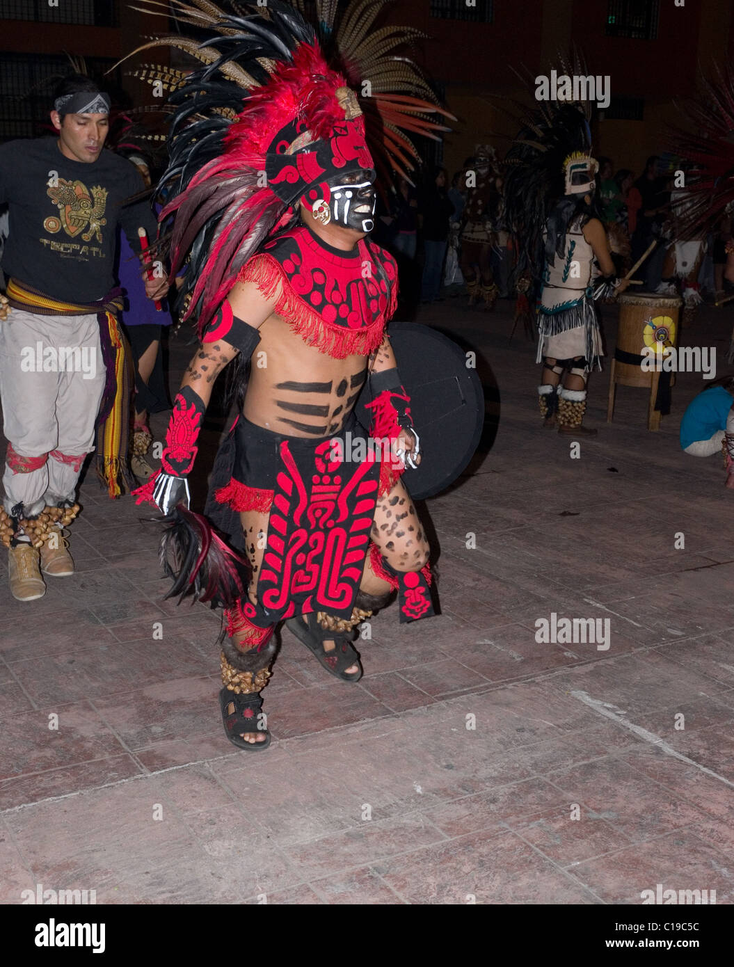 Man dressed as an Aztec warrior preforming a dance on the day of the dead in Xochimilco, Mexico Stock Photo