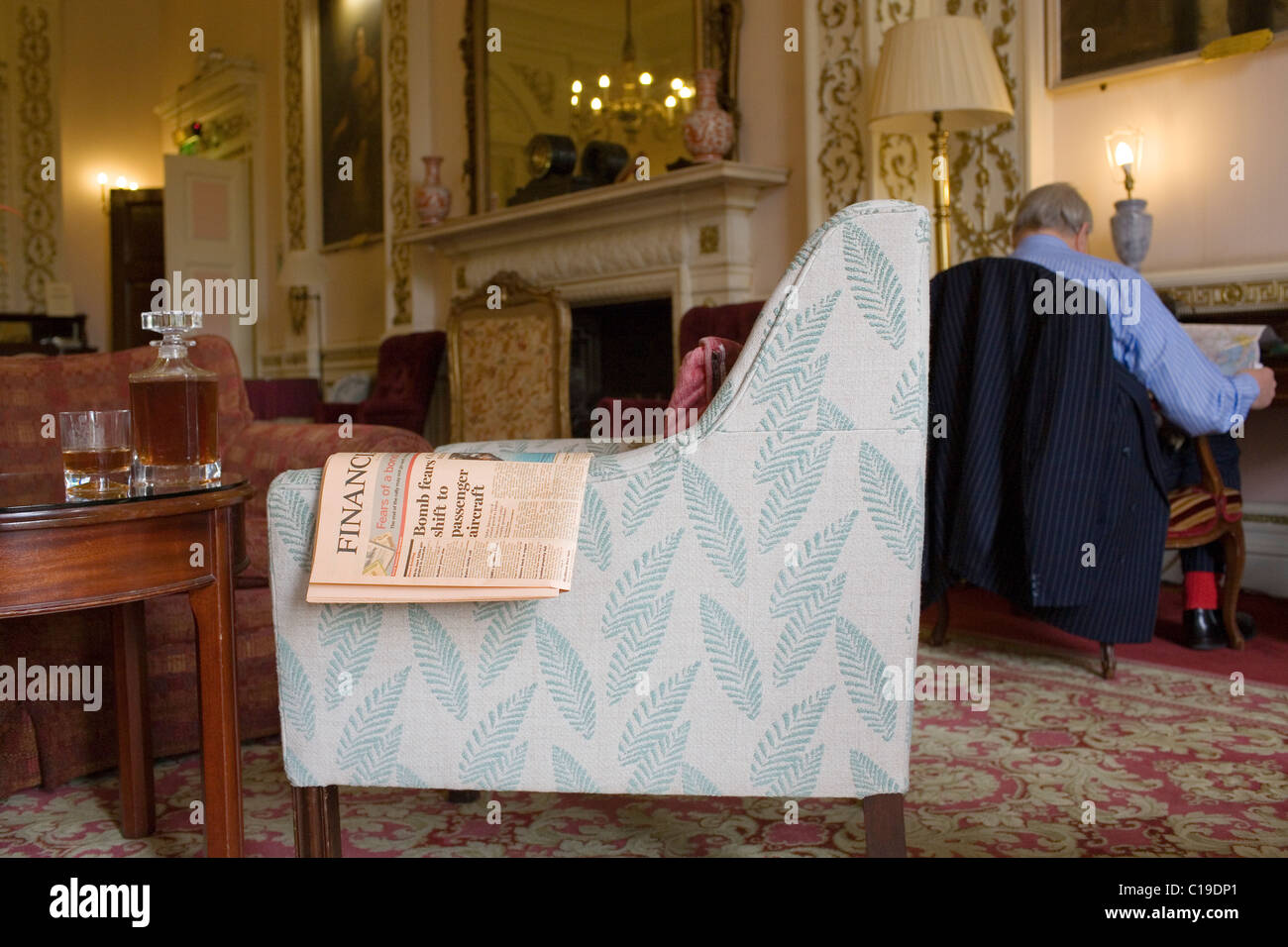 A copy of the Financial Times newspaper on the arm of a chair in the drawing room of a London private members club. - Stock Image