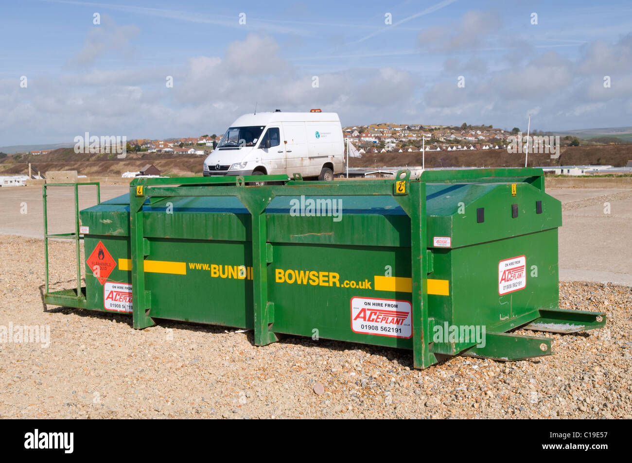 A Bunded Diesel Fuel Bowser used for refueling heavy plant on a beach at Seaford, East Sussex, UK - Stock Image