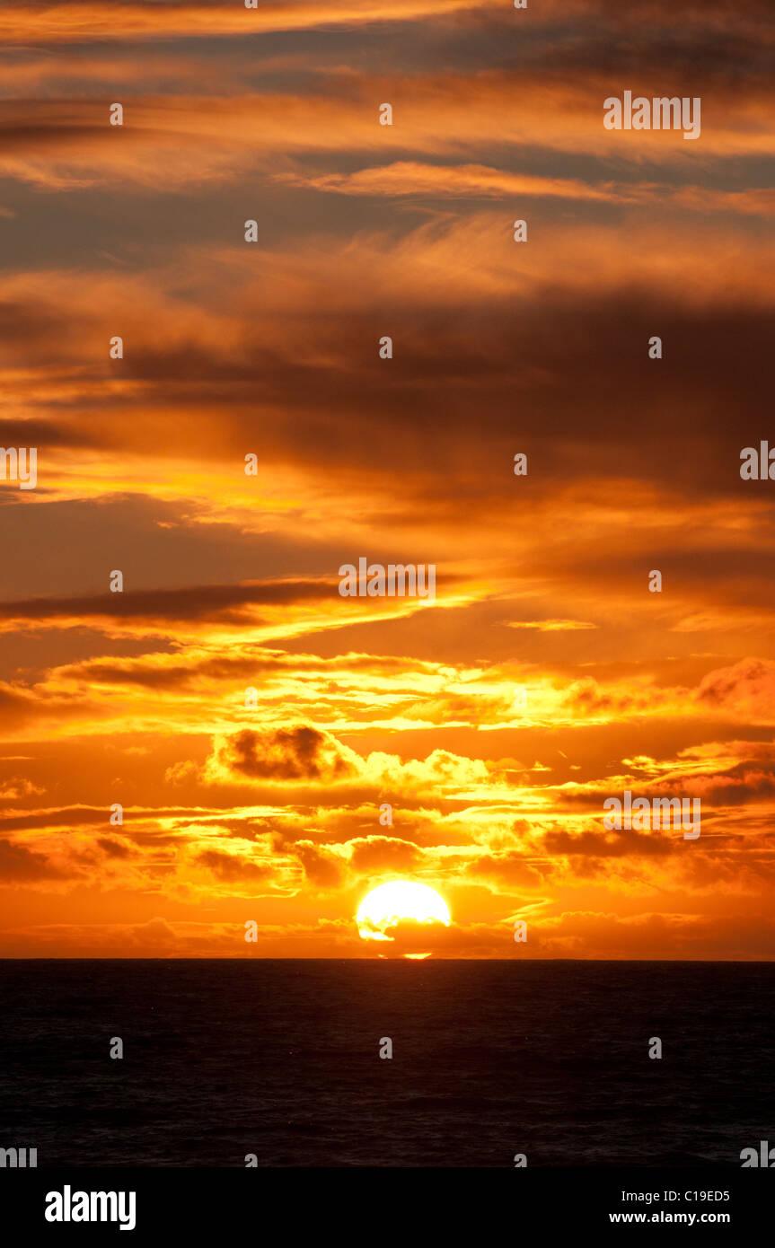 sunset,sun,beauty,nature,sea,coast,clouds,drama - Stock Image