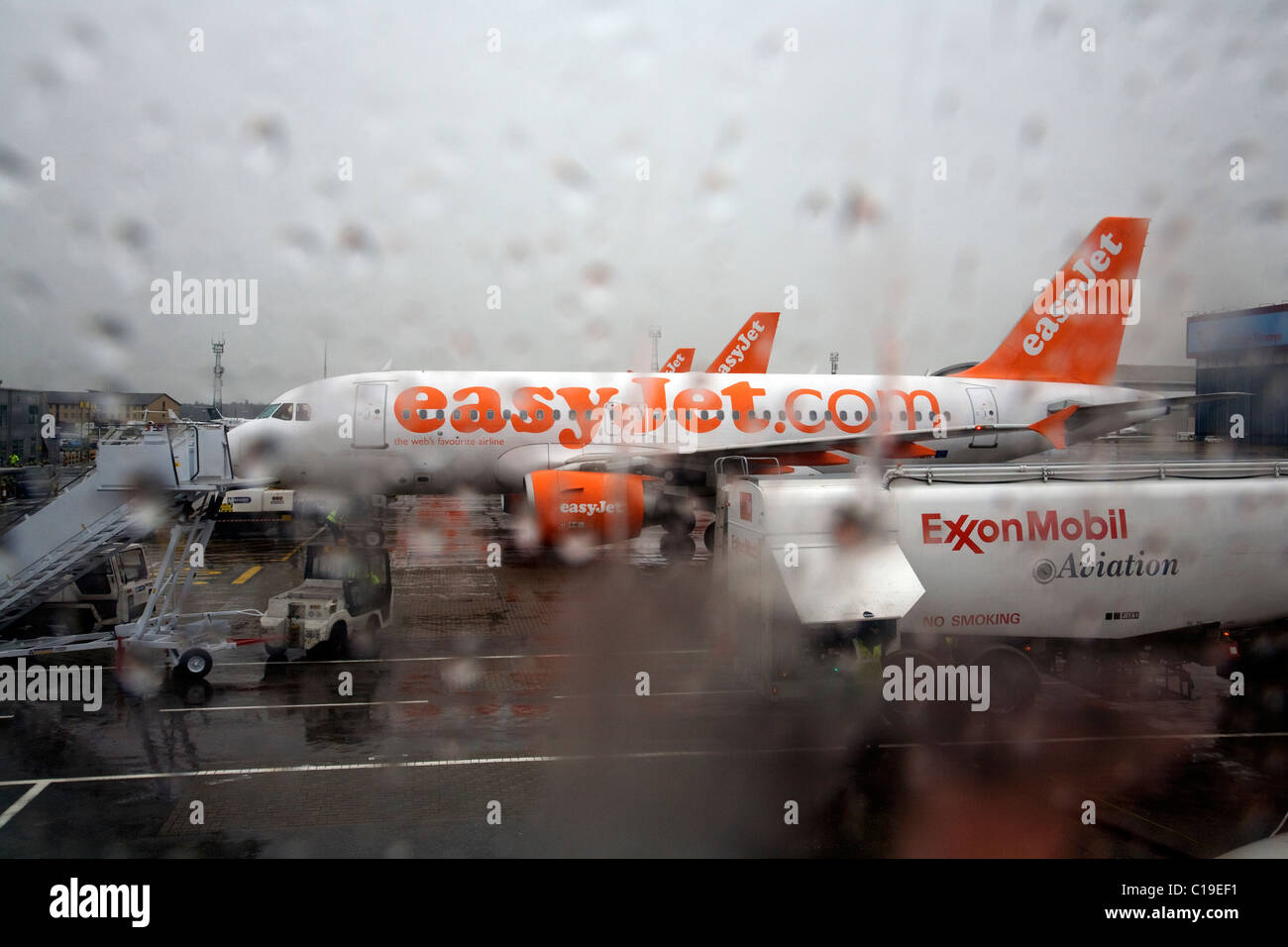 East jet air plane on rainy Sunday at Luton airport - Stock Image