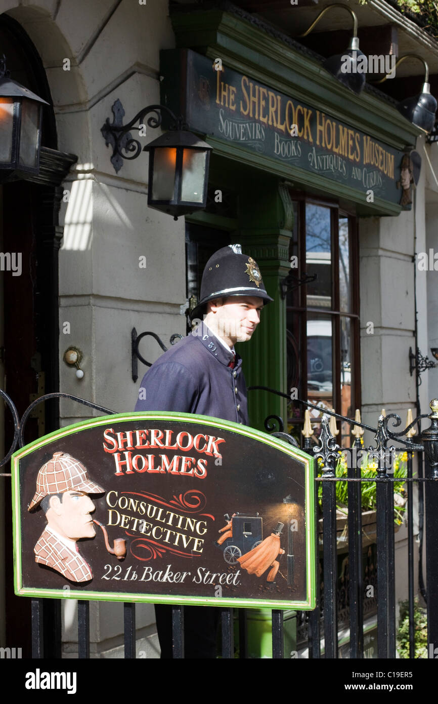 Sherlock Holmes Museum on Baker Street London With a Policeman Standing Guard - Stock Image