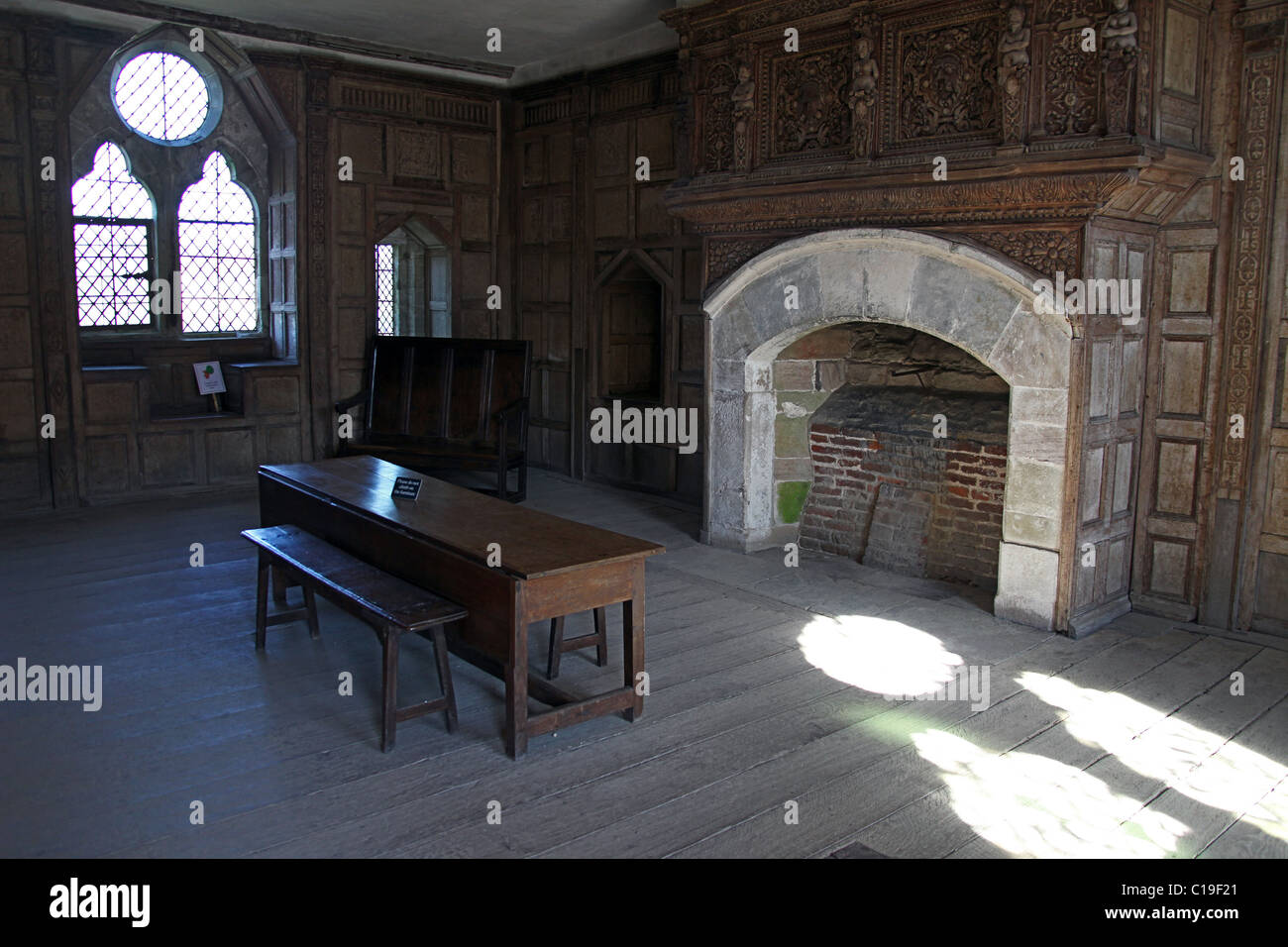 Open Hearth Fireplace And Decorative Window Inside The Great Hall At