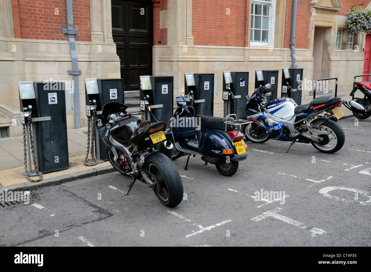 A motorcycle parking area with parking machines/meters close to the town centre of Leicester, Leicestershire, England. - Stock Image