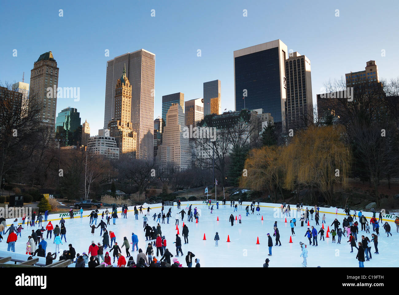 Central Park Ice Skate Rink, New York City Manhattan with skyscrapers - Stock Image