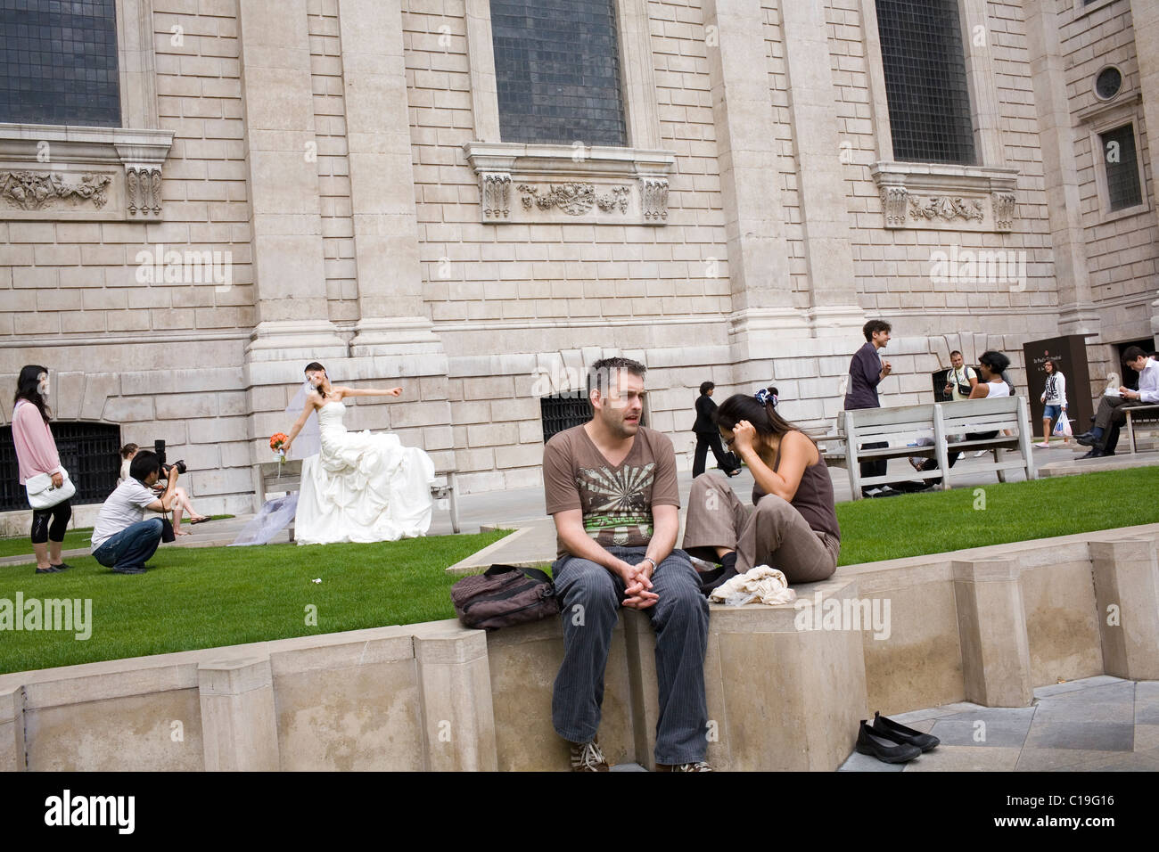An Asian bride is photographed in the grounds of Saint Paul's Cathedral. Stock Photo