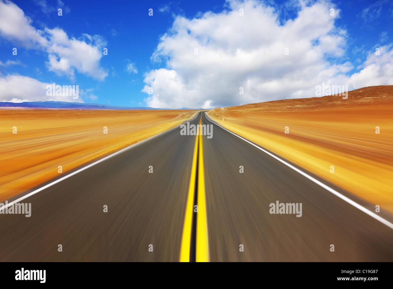Mirage on high speed in desert - Stock Image