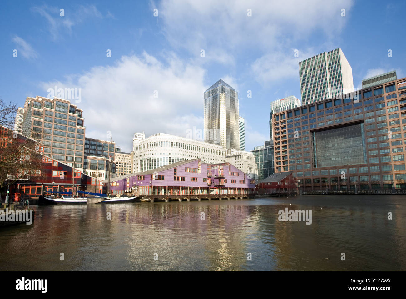 West India Millwall Docks and One Canada Square, Docklands, London, England, UK - Stock Image