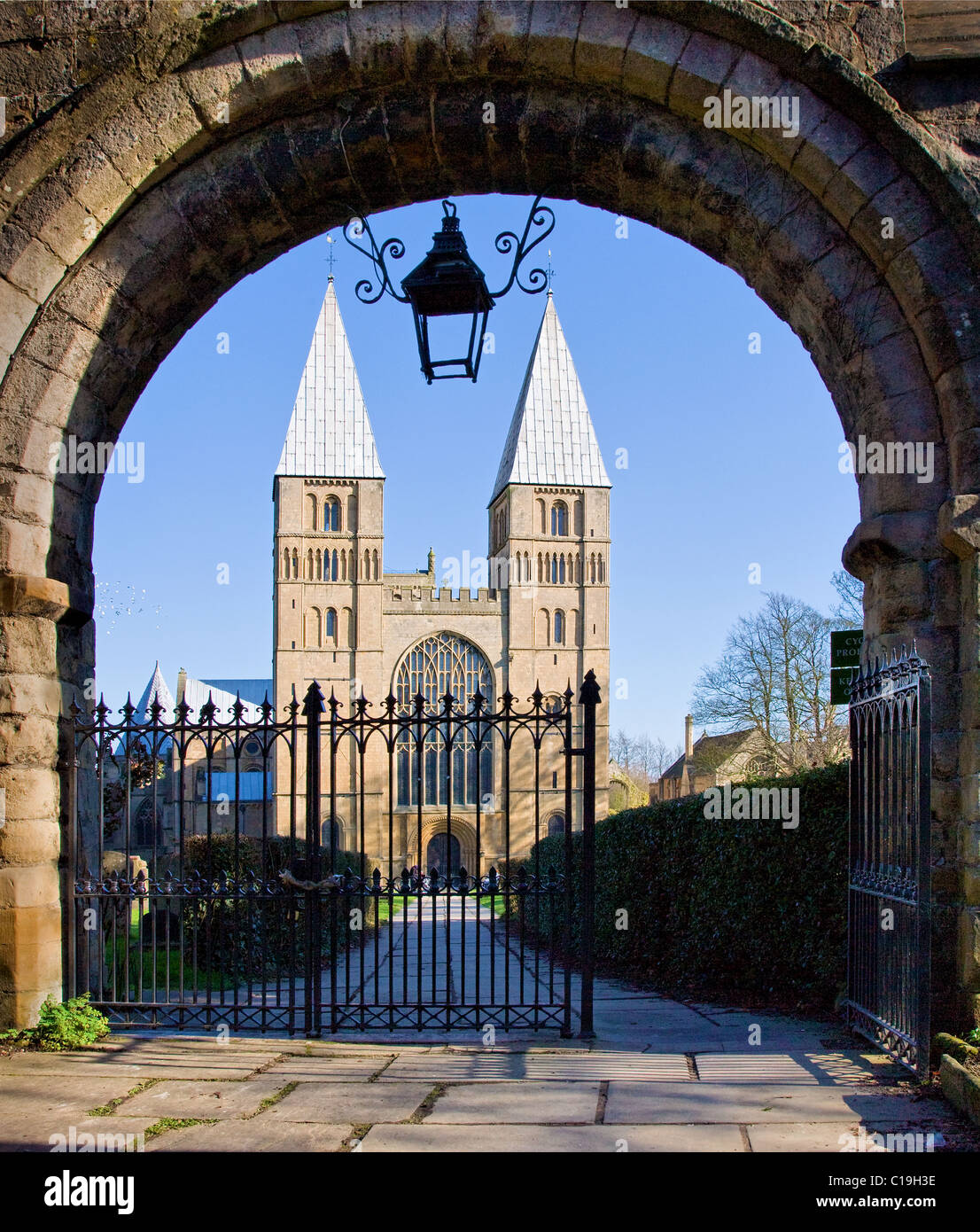 Southwell Minster in Nottinghamshire with unusual pepper pot towers glimpsed through the romanesque entrance gateway - Stock Image