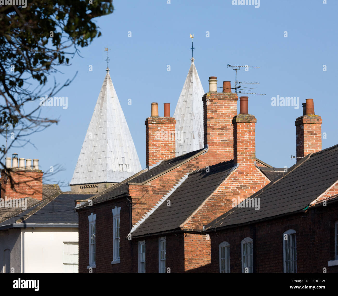 Southwell Minster in Nottinghamshire with its unusual pepper pot towers peering over surrounding houses - Stock Image