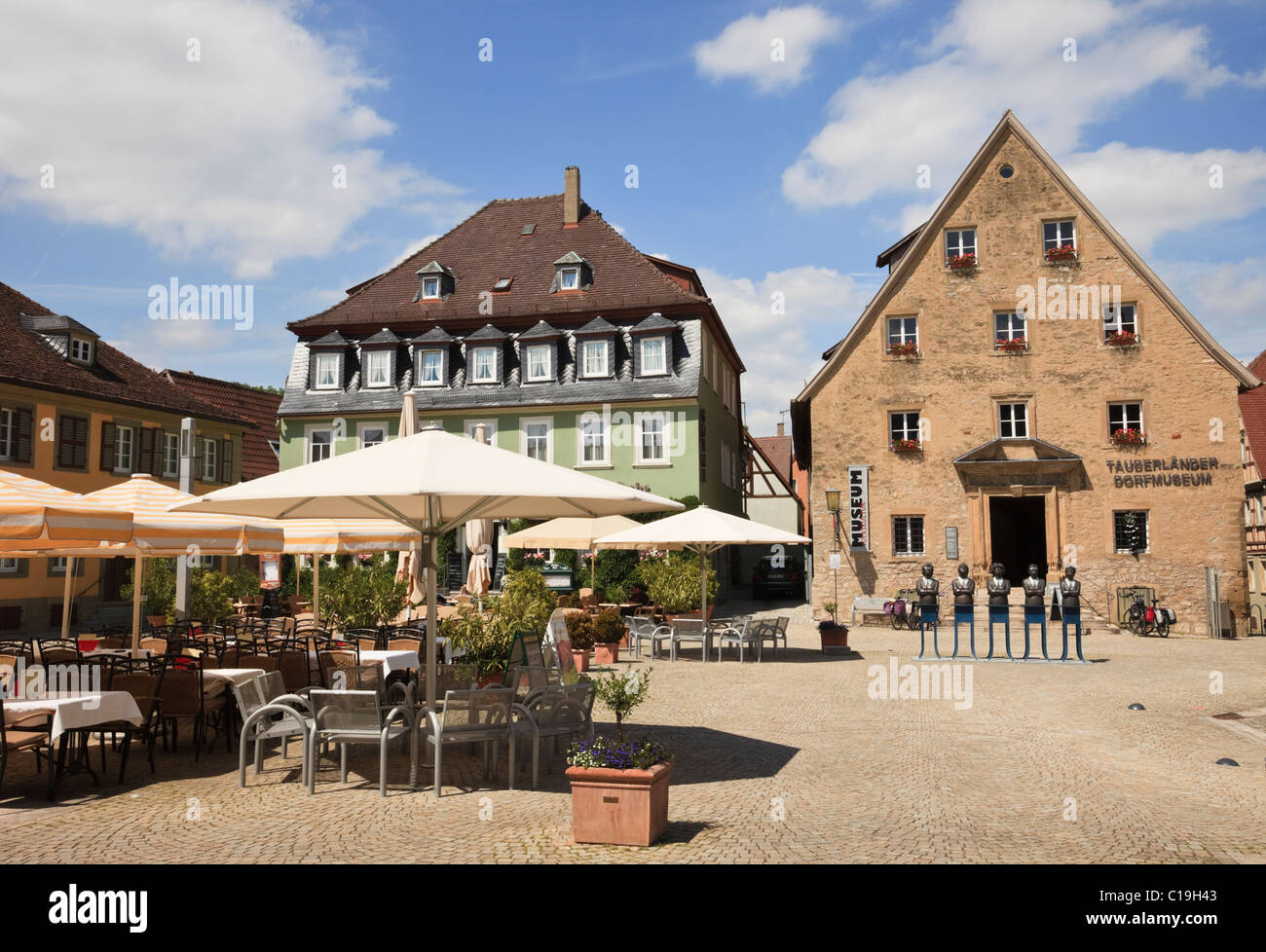 Weikersheim, Baden-Wurttemberg, Germany. Outdoor cafe and Tauberland Museum in medieval town square on the Romantic - Stock Image