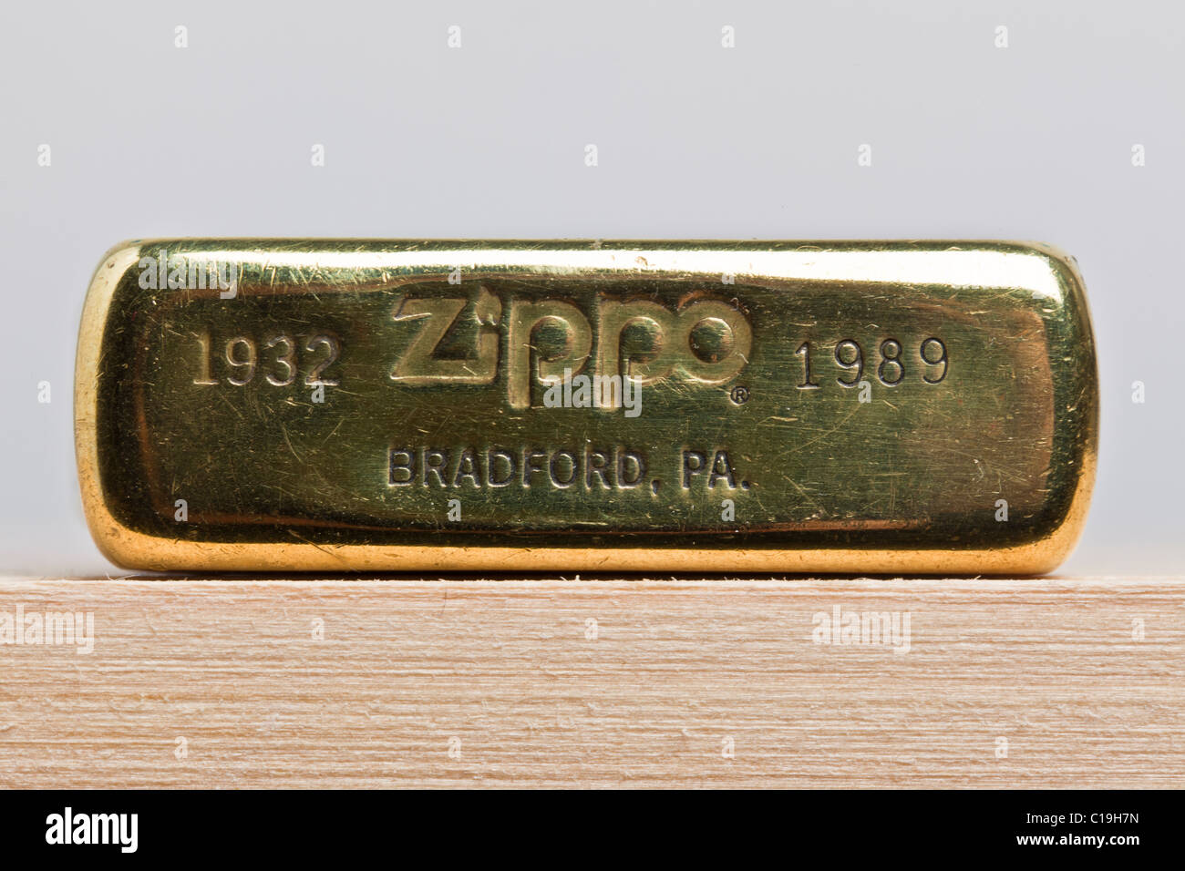 Base of brass Zippo lighter, showing logo - Stock Image