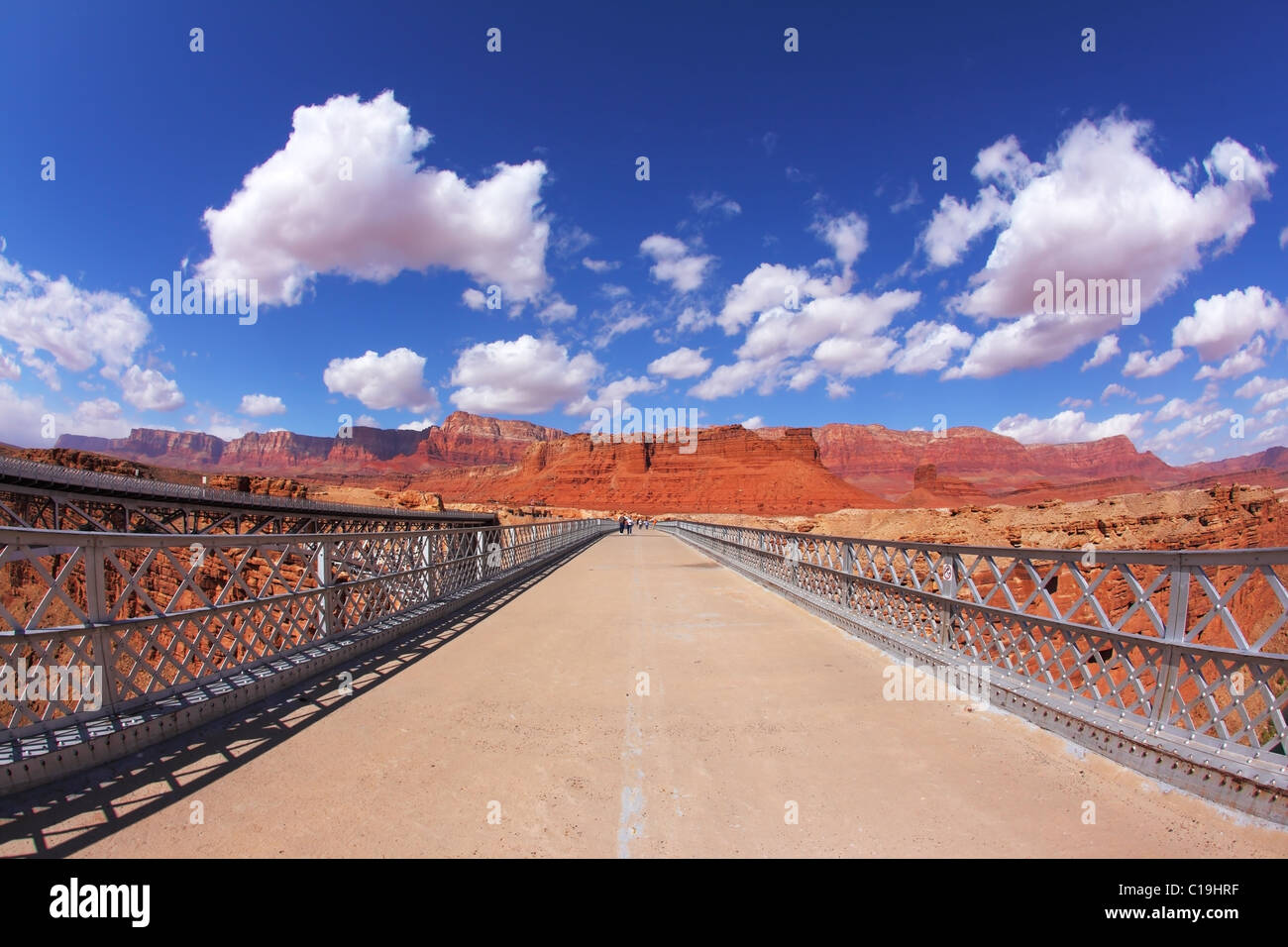 The bridge over the Colorado River and shining light clouds - Stock Image