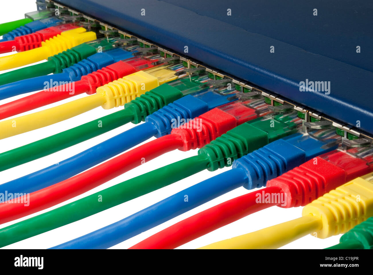 Multi colored rubber network cables attached to a blue router or switch isolated on white background - Stock Image