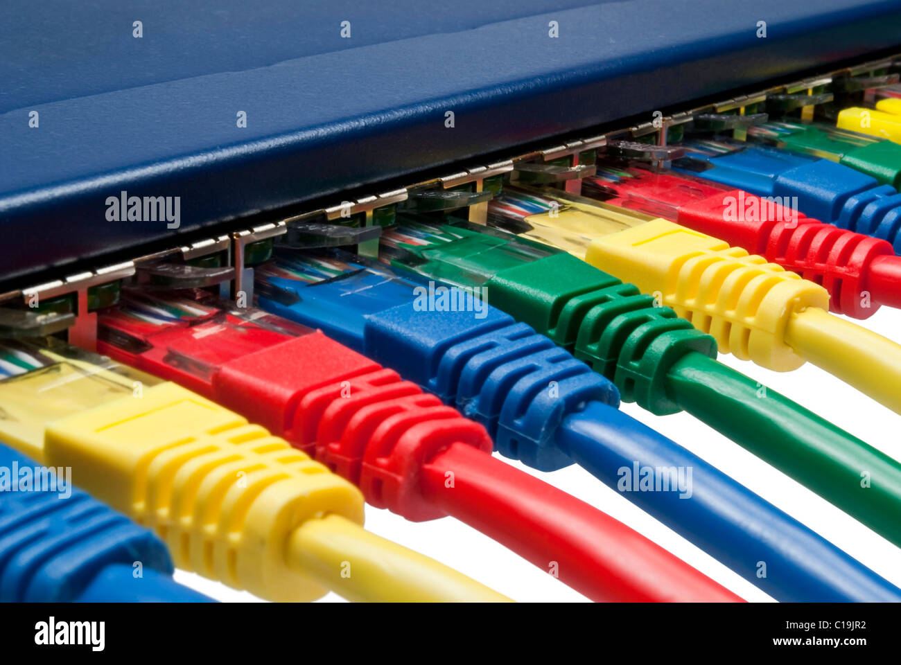 Macro closeup on colored network cables attached to a router or switch - Stock Image