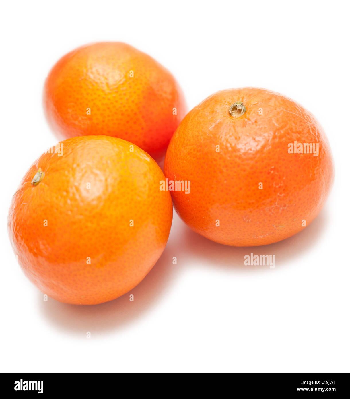 Group of three mandarin on white background - Stock Image