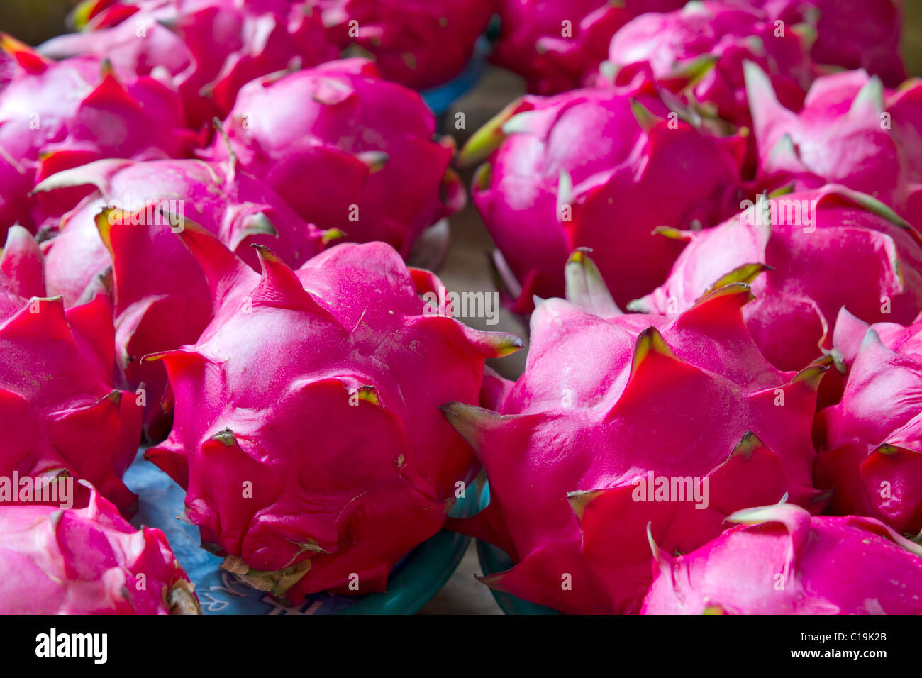 Dragon Fruit on Vendor Stand in Asian Country - Stock Image