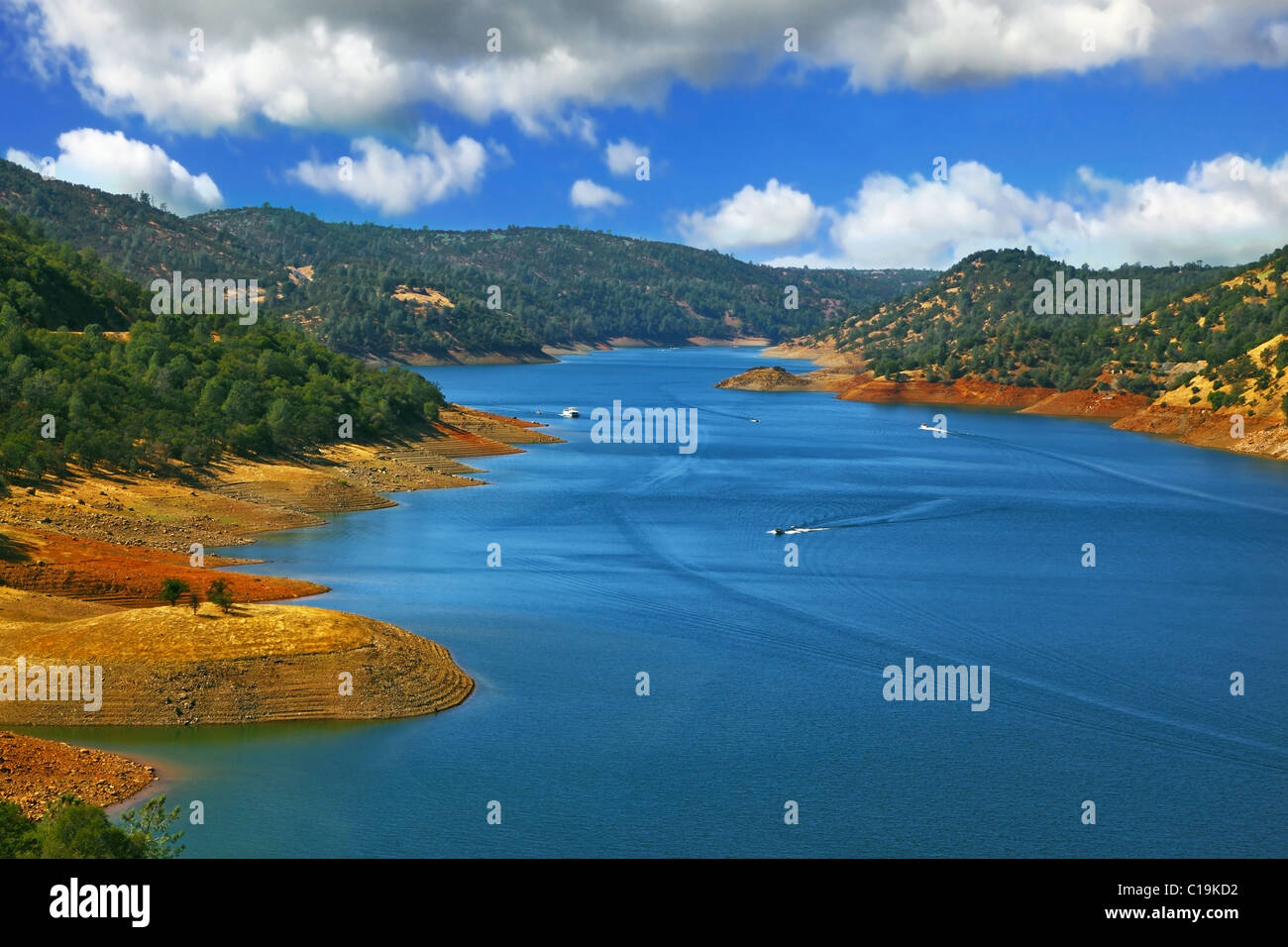Bright dark blue water and the charming rounded off sandy coast of the river Mersed - Stock Image