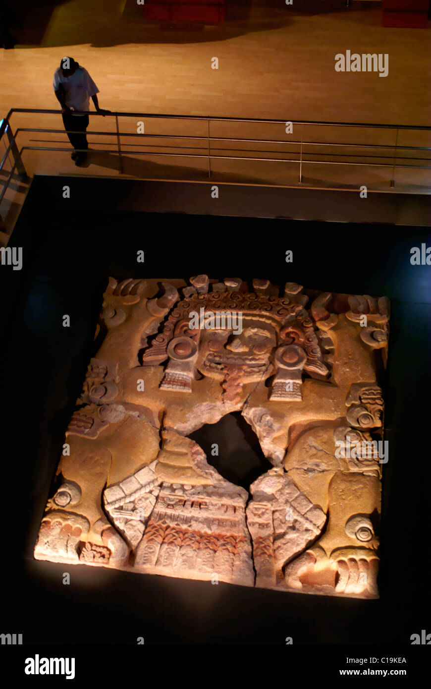 Person looking at the Tlaltecuhtli sculpture in the Templo Mayor Museum, Mexico City - Stock Image