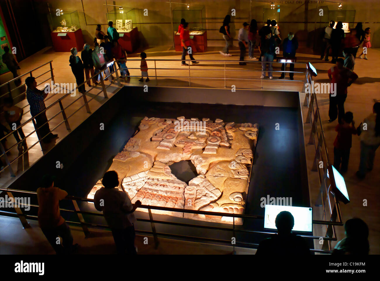 People at the Tlaltecuhtli sculpture exhibit in the Templo Mayor Museum, Mexico City - Stock Image